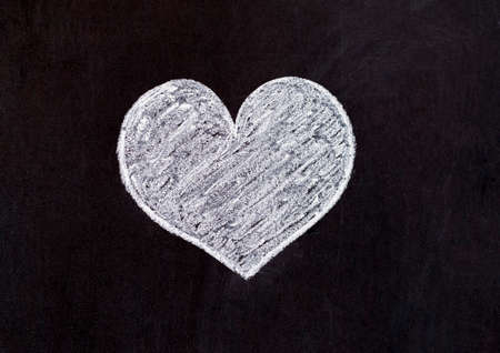 Lover of the heart drawn with chalk on a wooden board for all who love