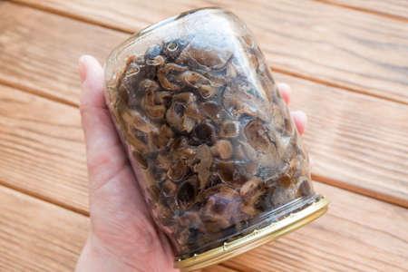 Armillaria fried mushrooms in a glass jar