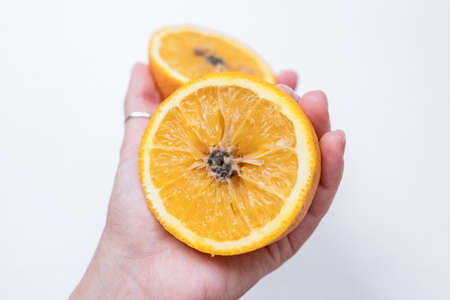 Spoiled orange. The black middle inside the fruit Reklamní fotografie