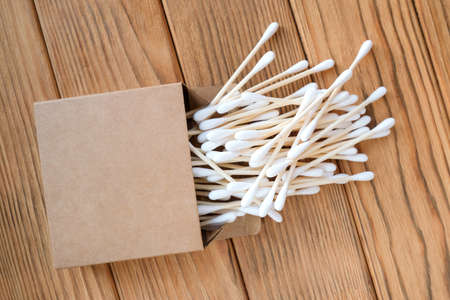Wooden cotton swabs. View from above. Wood background Foto de archivo