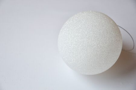white Christmas ball on white background. Christmas toy. Merry Christmas and happy New Year. Stock Photo