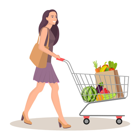 Beautiful young woman with shopping cart full of packages with vegetables and fruits. Happy smiling woman with products. Vector illustration in flat style, isolated on white Illusztráció