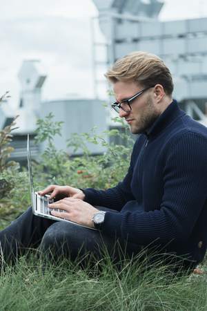 technologist: Handsome young businessman working on the roof