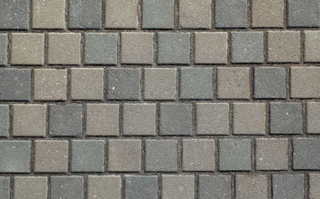 The texture of concrete tiles. background of the sidewalk of the city. the texture of the sidewalk of the street