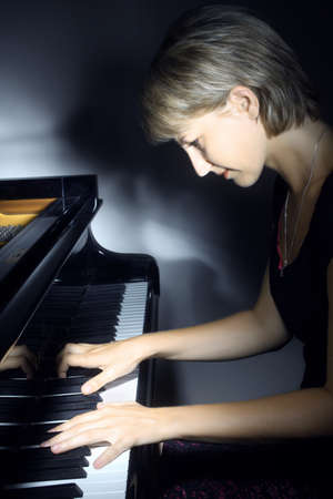 Piano music playing pianist musician. Musical instrument grand piano and woman performer.