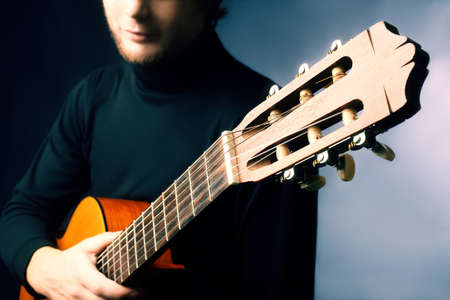 Acoustic guitar guitarist. Musical instrument with performer hand Stock Photo - 11882313