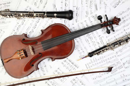 violins: Classical musical instruments notes. Violin oboe clarinet music instrument of symphony orchestra. Stock Photo