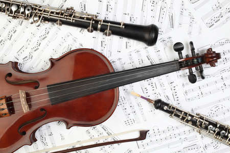 instruments: Classical musical instruments notes. Violin oboe clarinet music instrument of symphony orchestra. Stock Photo