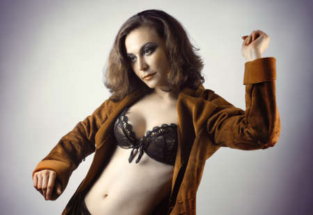 black bra: Pretty modern woman in black lingerie bra posing. Fashion portrait. Stock Photo