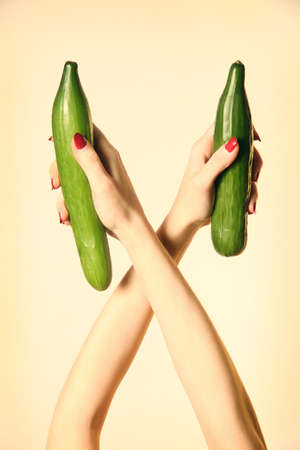 Hand cucumber. Cucumbers organic vegetable in the woman's hands. Stock Photo - 11882252
