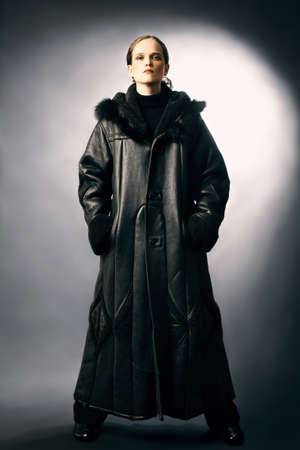 greatcoat: Sheepskin coat winter clothes fashion on woman. Black dress sheepskin-coat. Stock Photo