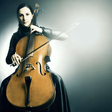young musician: Cello musical instrument cellist musician playing. Woman with cello
