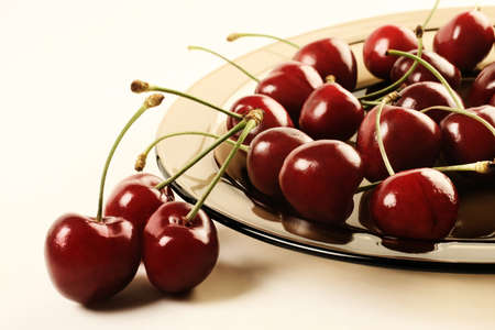 Cherry  Ripe cherries on the plate  photo