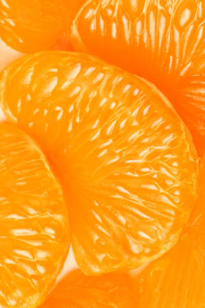 segment: Mandarin slice  Peeled tangerine slices orange background Stock Photo