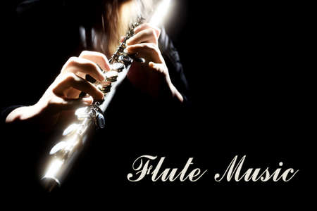 Flute music  Musical instrument flutist hands isolated on black photo