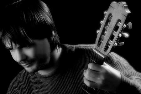 Guitarist portrait with guitar head photo