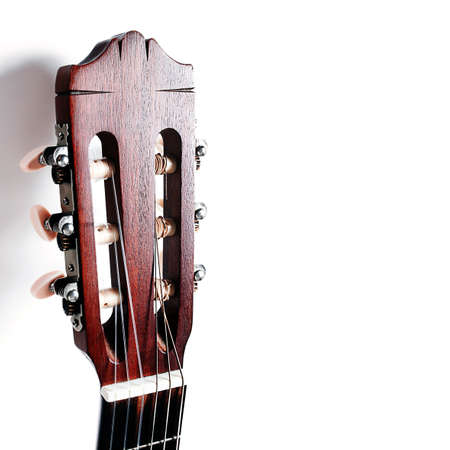 Acoustic guitar head neck on white background photo