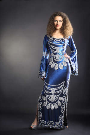 Fashion model in elegant dress. Woman portrait in Egyptian style clothes photo