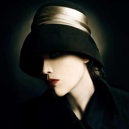 hat nude: Fashion portrait woman in black hat