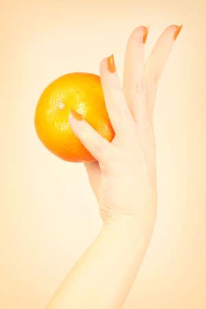 Orange manicure nails Hand with tangerine. Stock Photo - 16310633