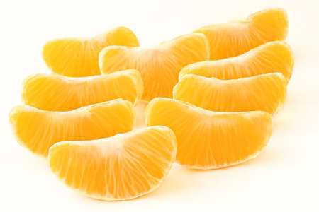 segments: Tangerine slice. Mandarin peeled sliced segments on white Stock Photo