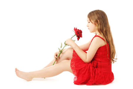 10 years old: Beautiful child girl with red rose. Pretty child 10 years old with flower isolated on white Stock Photo