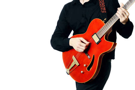 Electric Guitar Guitarist Playing six-string red guitar closeup isolated on white photo