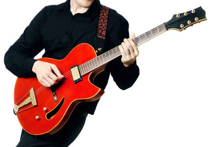 Guitar electric Guitarist playing red music instrument in hands closeup isolated on white photo