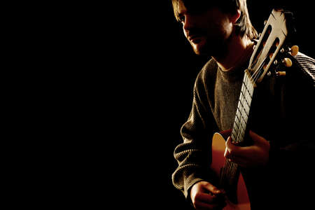 Guitar acoustic Guitarist playing classic music instrument closeup isolated on black photo