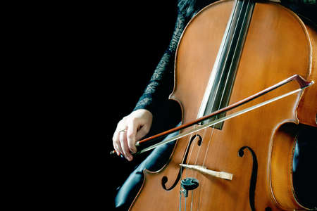 cellist: Cello playing cellist orchestra musical instruments Stock Photo