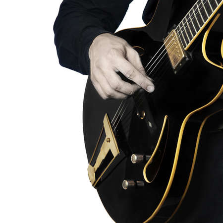 Guitar electric Guitarist playing black music instrument in hands closeup isolated on white photo