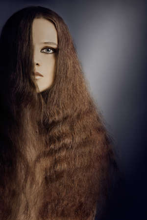 Woman hairstyle with long hair. Beautiful model half face photo