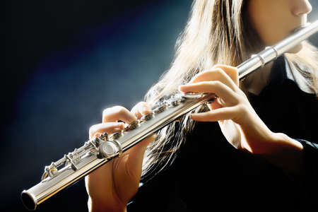 concert flute: Flute music flutist instrument playing  Player hands closeup Stock Photo