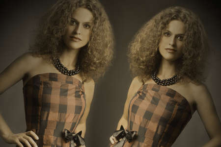 Fashion woman portrait. Twins with beautiful curly thick hair Stock Photo - 17385050