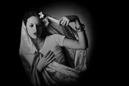 yashmak: Woman in Indian fashion dark romantic portrait in black and white Stock Photo