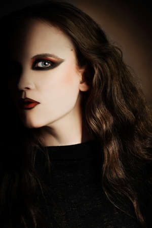 Woman portrait face with vamp makeup in gothic style photo