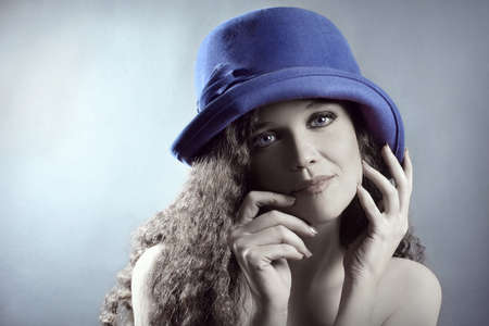 Fashion portrait young woman in elegant hat. Beautiful retro girl in blue hat Stock Photo - 17385048