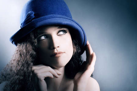Fashion portrait young woman in elegant hat. Beautiful retro woman in blue hat Stock Photo - 17385038