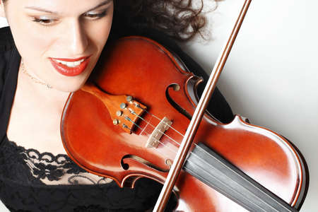 dynamical: Violin playing violinist musician. Player with insrtument closeup Stock Photo