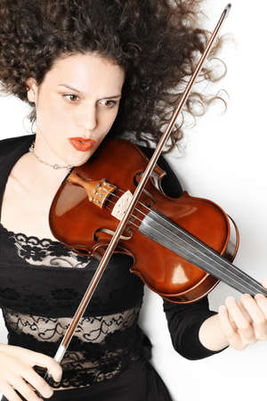 Violin playing violinist expressive musician. Woman player performer portrait photo