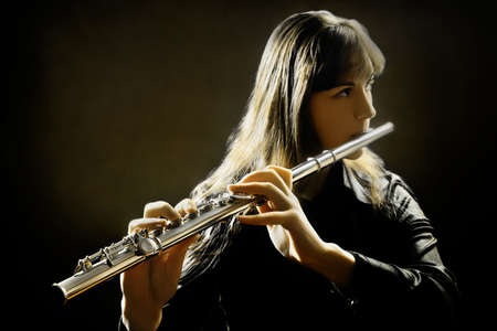 Flute music flutist instruments playing. Classical orchestra musician. Focus is on the hands with instrument photo