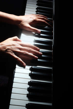 Piano keys pianist hands keyboard. Musical instrument details with player hand closeup