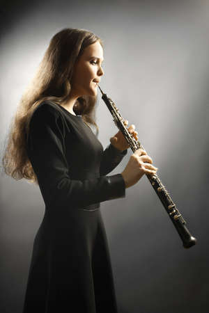 Classical musician oboe playing. Oboist with orchestra musical instrument Foto de archivo