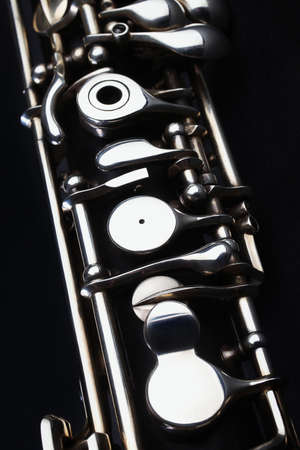 Oboe - musical instruments of symphony orchestra  Oboe mechanism detail closeup on black photo