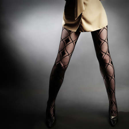 Fishnet stockings legs  Woman in black stockings photo
