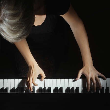 Piano keys pianist hands playing