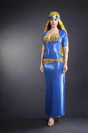 Oriental fashion woman dancer in elegant Egyptian style dress Stock Photo - 19968358