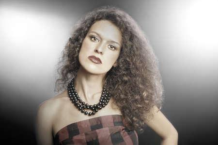 attractive gorgeous: Fashion portrait of curly brunette woman