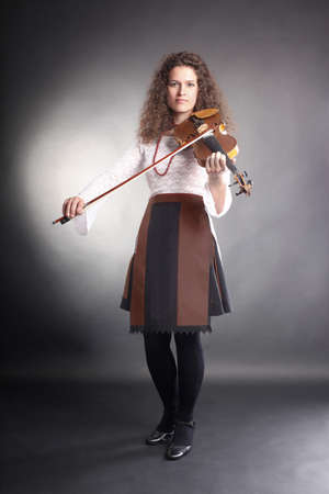 Violin player playing classical music. photo