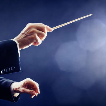 orchestra: Music conductor hands orchestra conducting Stock Photo
